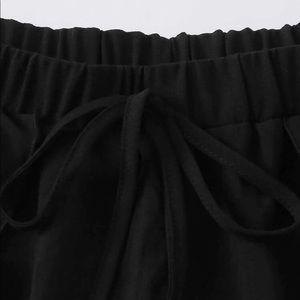 Ruffled black shorts